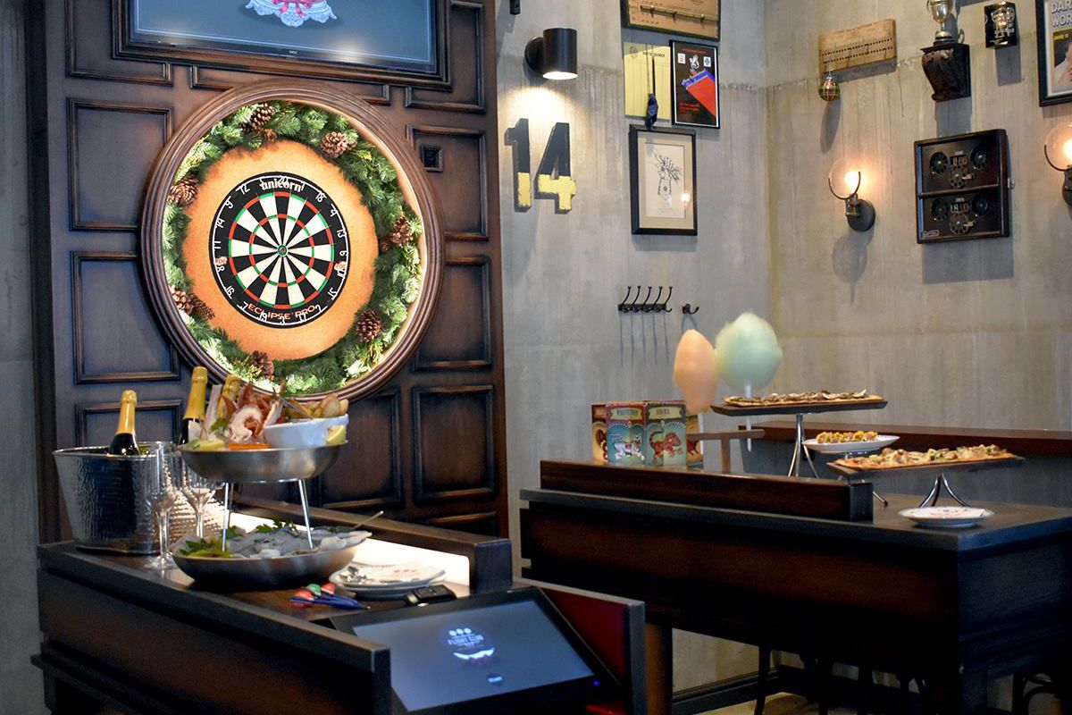 A dart board with food set up on either side
