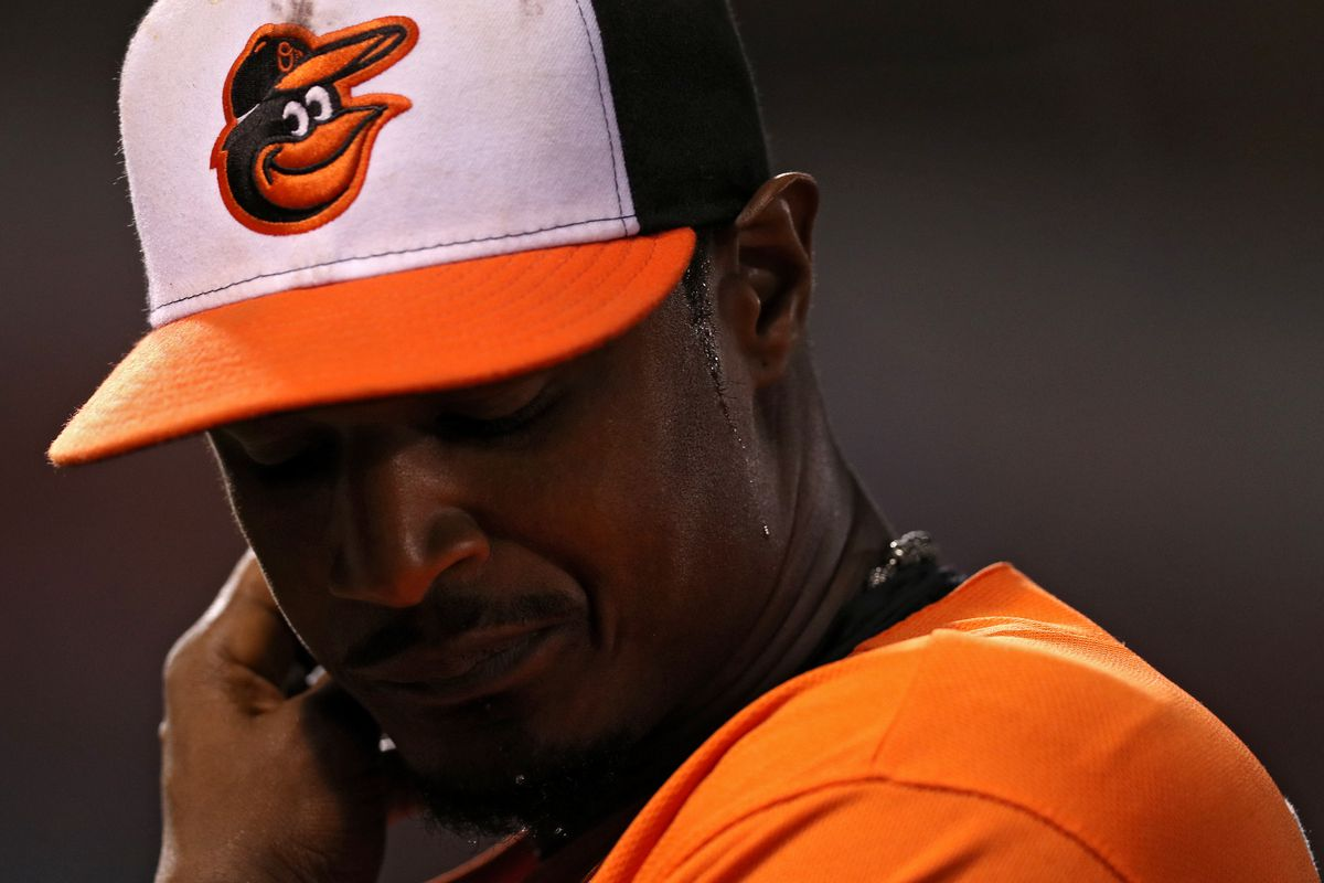 Adam Jones looks disgusted about something in an Orioles game.