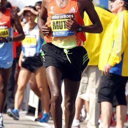 Geoffrey Mutai, of Kenya, warms up prior to the start of the 116th running of the Boston Marathon, in Hopkinton, Mass., Monday, April 16, 2012. (AP Photo/Stew Milne)