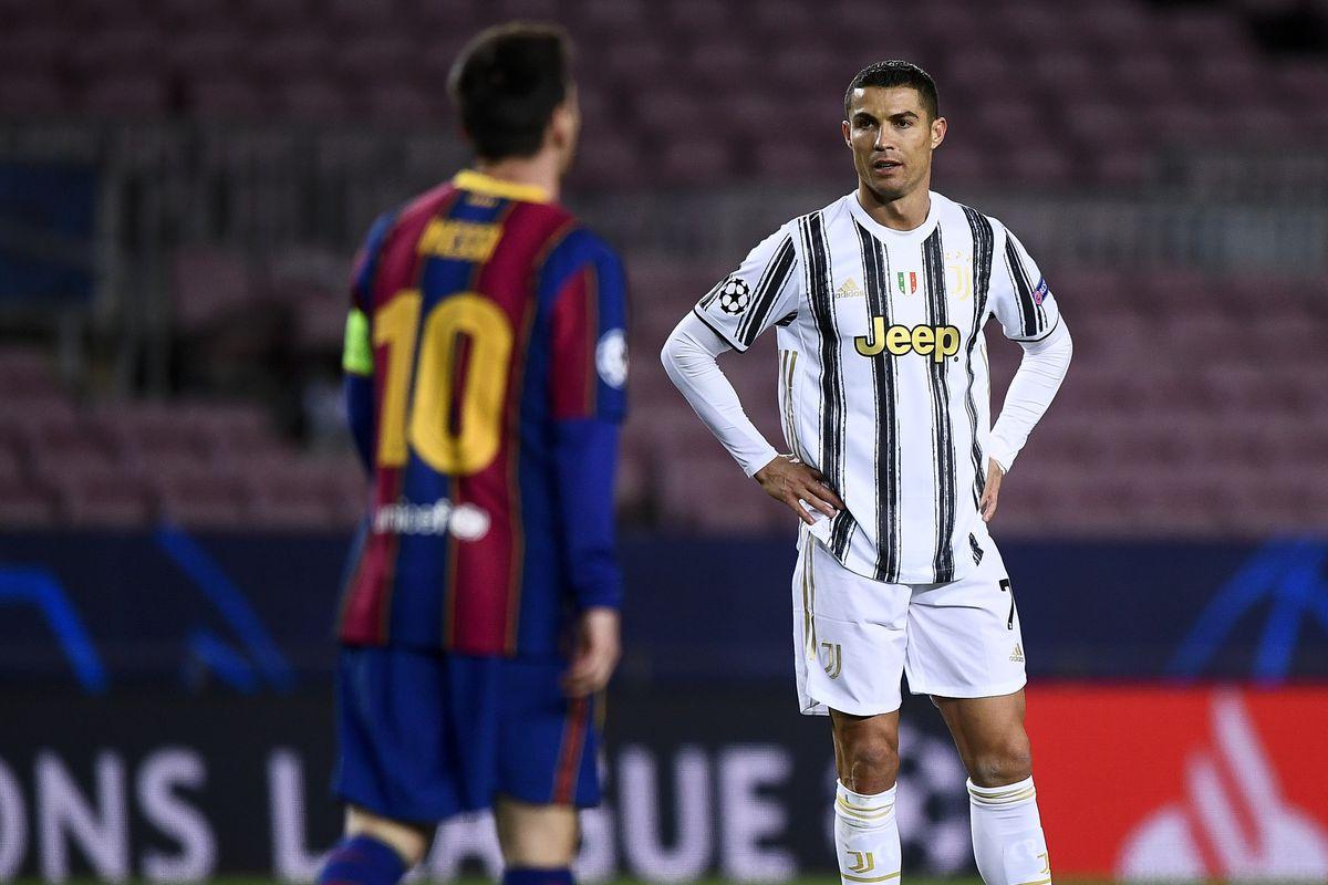 Cristiano Ronaldo (R) of Juventus FC and Lionel Messi of FC...