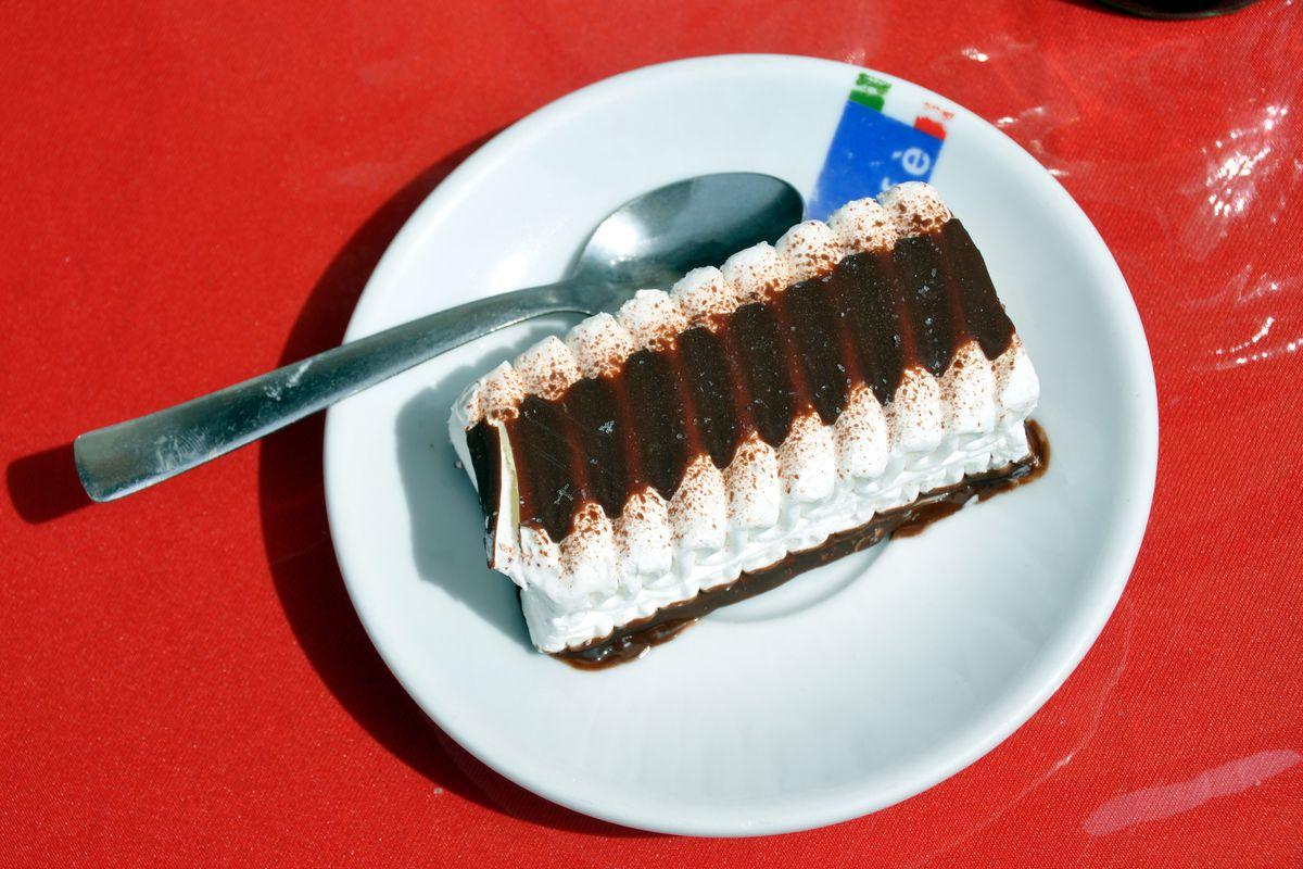 A Viennetta ice cream cake on a white plate