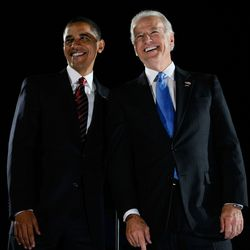 Barack Obama and Joe Biden smile on stage after Obama gave his victory speech.| Joe Raedle/Getty Images