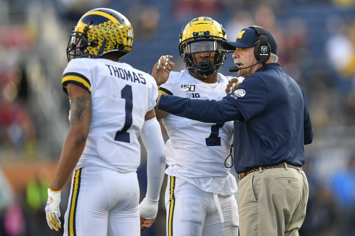 Michigan defensive coordinator Don Brown speaks to Michigan Wolverines linebacker Khaleke Hudson during the second half of the Citrus Bowl between the Michigan Wolverines and the Alabama Crimson Tide on January 01, 2020, at Camping World Stadium in Orlando, FL.