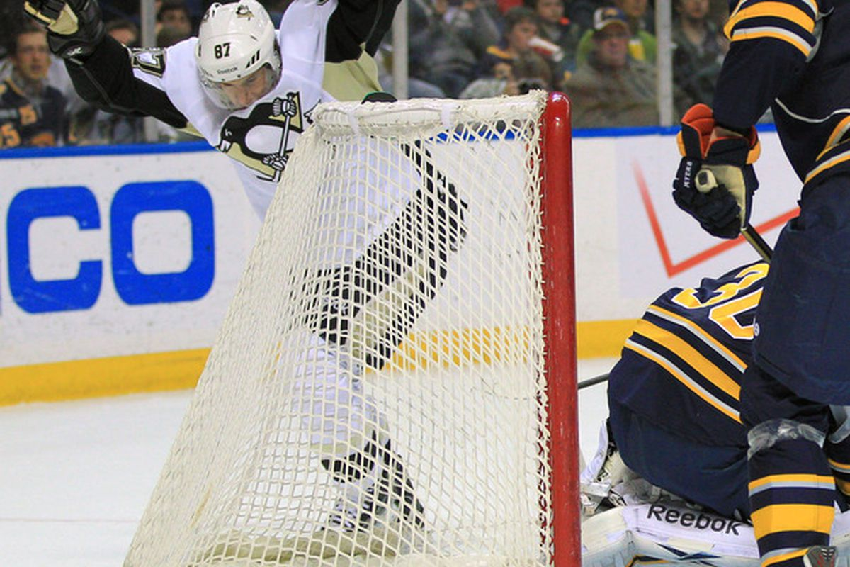 Mar 30, 2012; Buffalo, NY, USA; Pittsburgh Penguins center Sidney Crosby (87) scores on Buffalo Sabres goalie Ryan Miller (30) during the first period at the First Niagara Center. Mandatory Credit: Kevin Hoffman-US PRESSWIRE