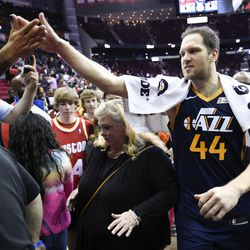 Utah Jazz forward Bojan Bogdanovic (44) high-fives a fan after shooting the game-winning three point basket during the second half of an NBA basketball game against the Houston Rockets, Sunday, Feb. 9, 2020, in Houston.