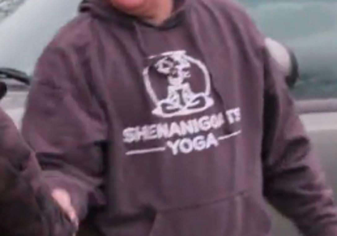 "Close-up of a sweatshirt that says ""Shenanigoats Yoga"""