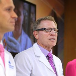 Dr. Lincoln Nadauld, executive director of Intermountain Precision Genomics, left, and Linda Warner, a breast cancer survivor, right, listen as Dr. Brett Parkinson, a radiologist with the Breast Care Center at Intermountain Medical Center, discusses the launch of a cutting-edge genomics breast cancer study for Utah women during a press conference in Murray on Monday, Oct. 9, 2017. The study seeks to determine whether specific blood tests that look for DNA from cancer tumors can be used to complement screening mammography to improve the way breast cancer is diagnosed.
