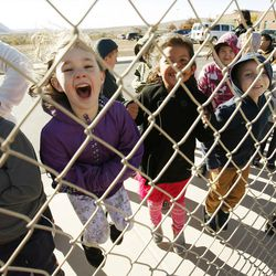 Hurricane Elementary schoolchildren yell for Santa as Santa Flight volunteers bearing Christmas gifts land in Hurricane on Wednesday, Dec. 7, 2016. Pilots with the Utah Wing of Angel Flight West filled 16 aircraft with 7,000 pounds toys, school supplies, books, backpacks and warm clothing for the Title I schoolchildren. The items were gathered by 16 Boy Scouts as part of their Eagle Scout service project. Since the first Santa Flight in 2000, members of the Utah Wing have worked with their local communities to gather needed supplies and toys, and deliver them to Title I schools in rural communities throughout Utah.