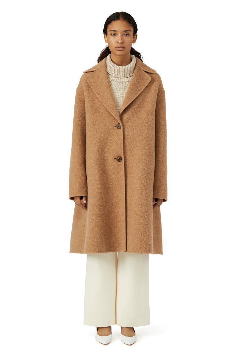 A model in a camel coat