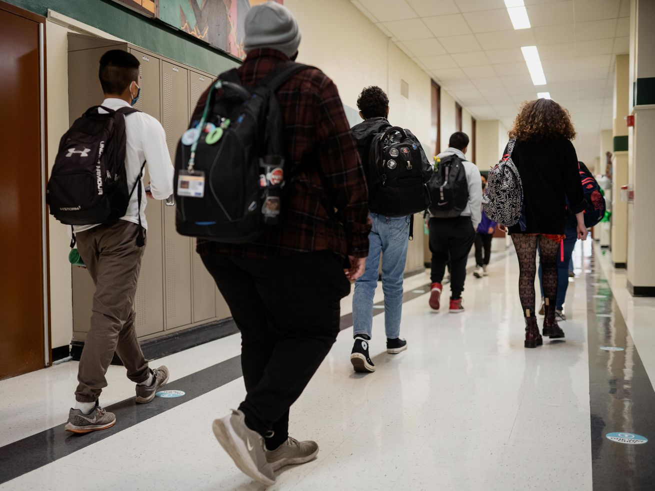 Students walk down the hall at Nicholas Senn High School in the Edgewater neighborhood, Friday afternoon, April 23, 2021. Chicago Public Schools students will return to schools Monday.
