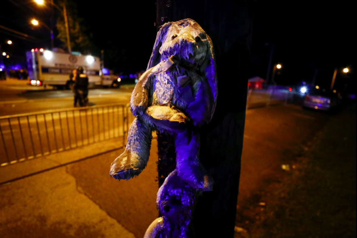 A soaked teddy bear hangs from a telephone pole near where protesters took to the streets of Frayser in the wake of an officer-involved shooting on Wednesday, June 12, 2019, that left one person dead.