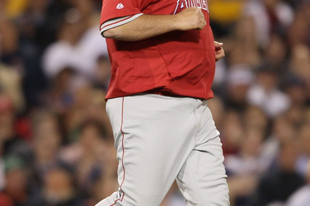 BOSTON - MAY 06:  Manager Mike Scioscia #14 of the Los Angeles Angels of Anaheim runs on the field to discuss a call in the fifth inning against the Boston Red Sox on May 6, 2010 at Fenway Park in Boston, Massachusetts.  (Photo by Elsa/Getty Images)