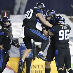 BYU quarterback Zach Wilson (1), tight end Lane Lunt (80), BYU tight end Carter Wheat (96) and Isaac Rex (83) celebrate a touchdown in the first half of an NCAA college football game against San Diego State Saturday, Dec. 12, 2020, in Provo, Utah.