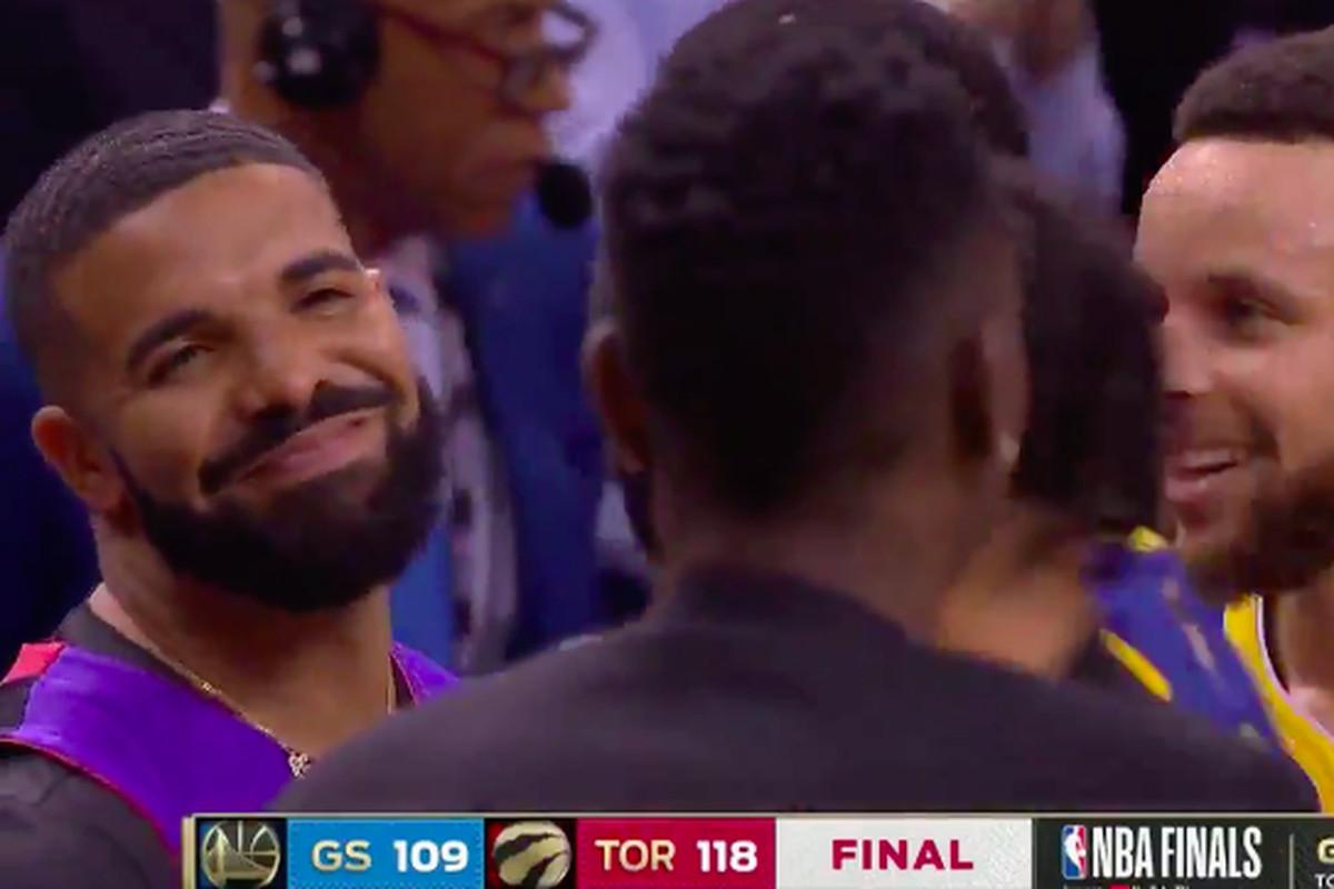28237a8b37c Raptors beat Warriors in Game 1, Drake celebrates as only Drake can ...