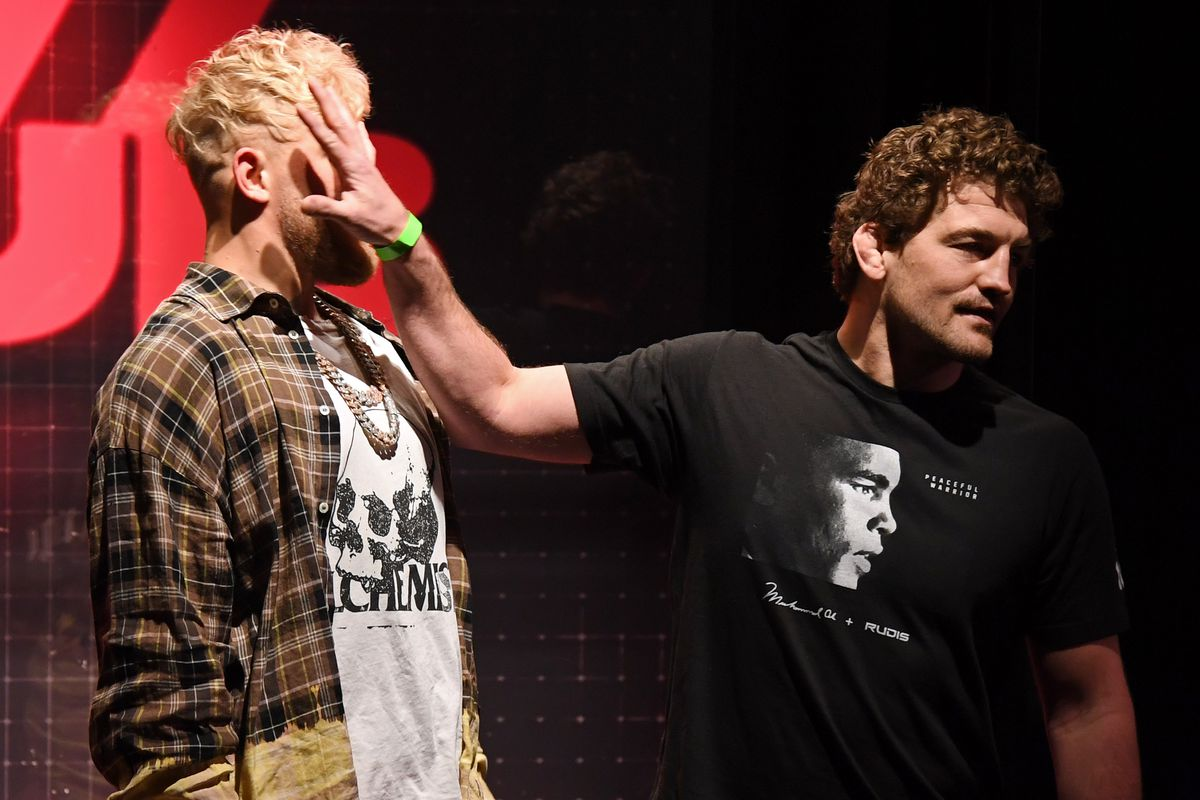 Ben Askren shoves Jake Paul as they face off during a news conference for Triller Fight Club's inaugural 2021 boxing event at The Venetian Las Vegas on March 26, 2021 in Las Vegas, Nevada. Paul and Askren will face each other in the main event that will take place on April 17, 2021, at Mercedes-Benz Stadium in Atlanta.