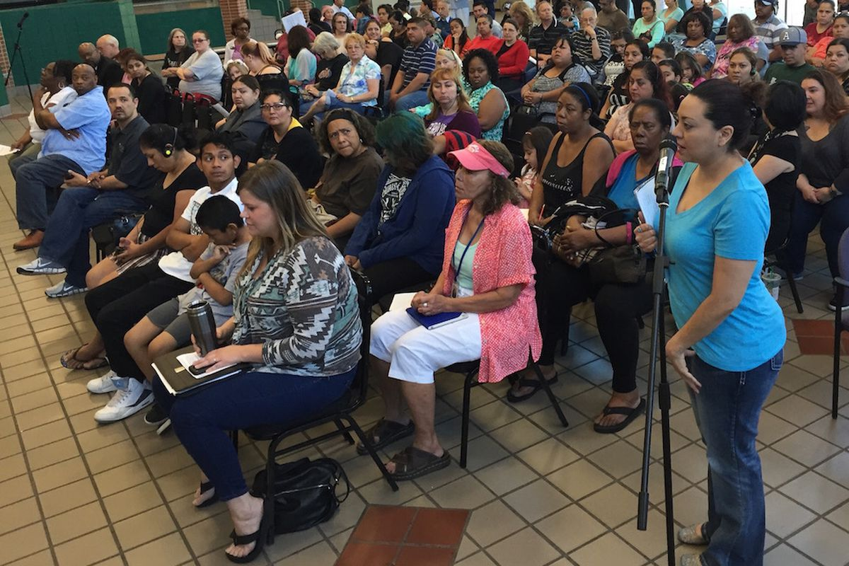 Sandra Sarabia, the mother of an incoming freshman at Aurora Central, speaks during a town hall meeting Saturday to discuss the future of the academically struggling school.