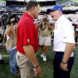 Tampa Bay Buccaneers head coach Greg Schiano, left, and New York Giants head coach Tom Coughlin exchange words at the end of an NFL football game Sunday, Sept. 16, 2012, in East Rutherford, N.J. The Giants won the game 41-34.