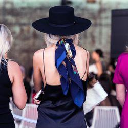 A vintage silk scarf worn with a silk slip and wide-brimmed hat.