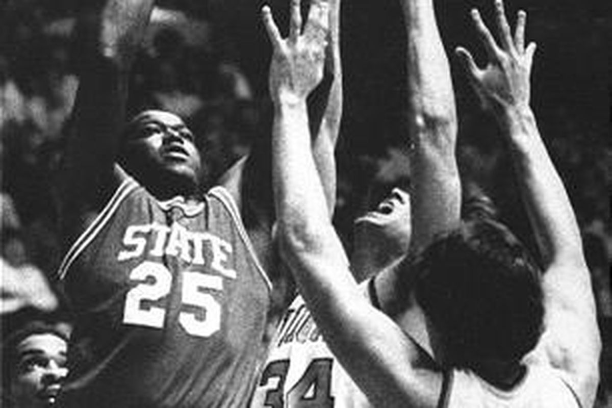"""North Carolina State's Dereck Whittenburg (25) drives toward the basket against Virginia's Rick Carlisle (34) and Jim Miller in their NCAA West Regional Championship game in Ogden in 1983. North Carolina State won 63-62 to advance to the Final Four """""""" and"""