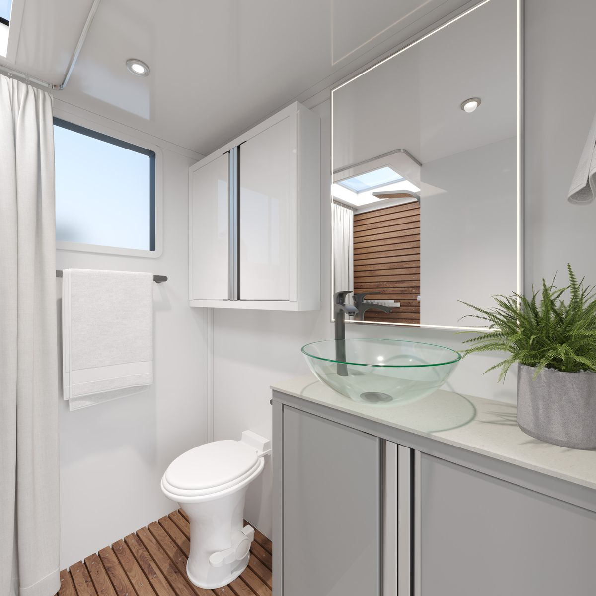 A bathroom with a white toilet, gray cabinets, a glass bowl sink, mirrors, and walnut flooring.