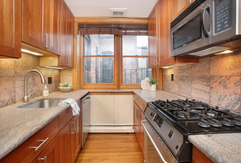A kitchen with a narrow opening between the counters.