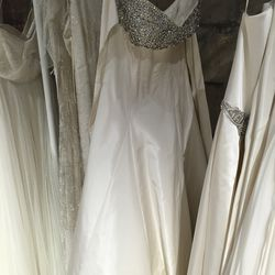 Bridal gown with beaded top, $1,500 (was $3,885)