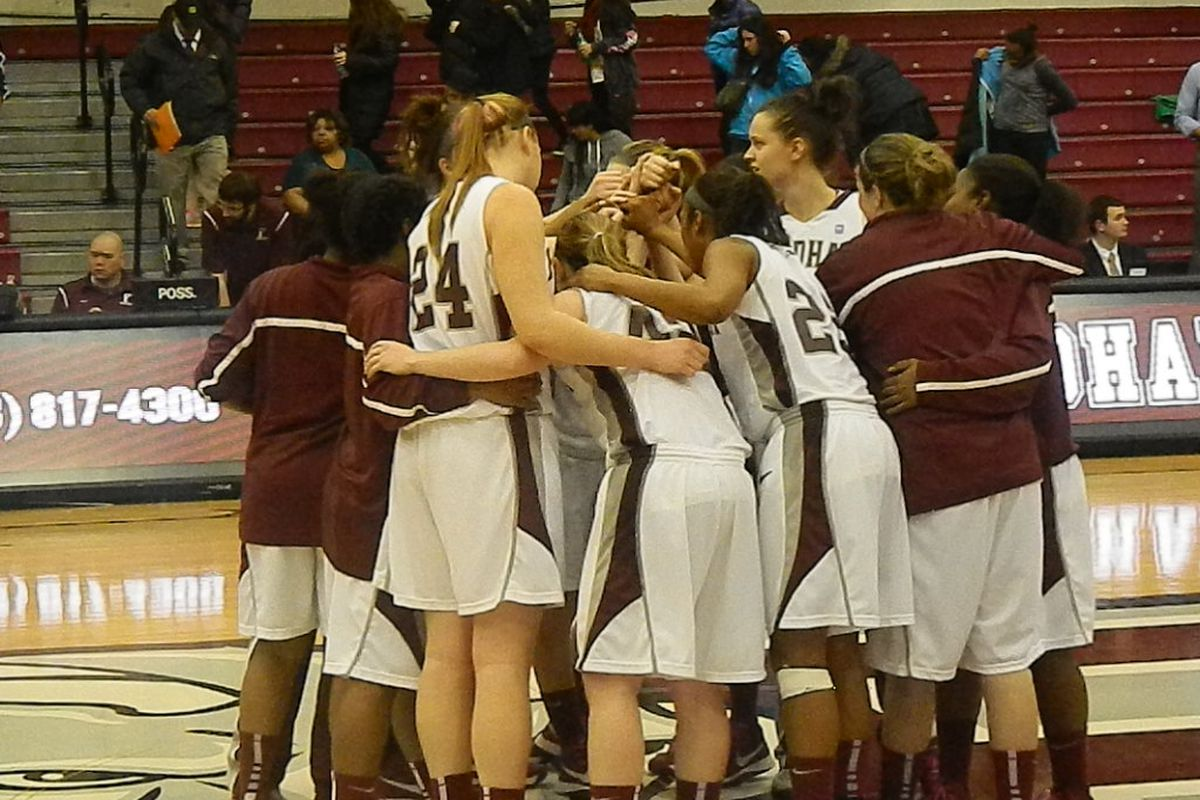 The Fordham Rams gather at center court following their win over St. Bonaventure.
