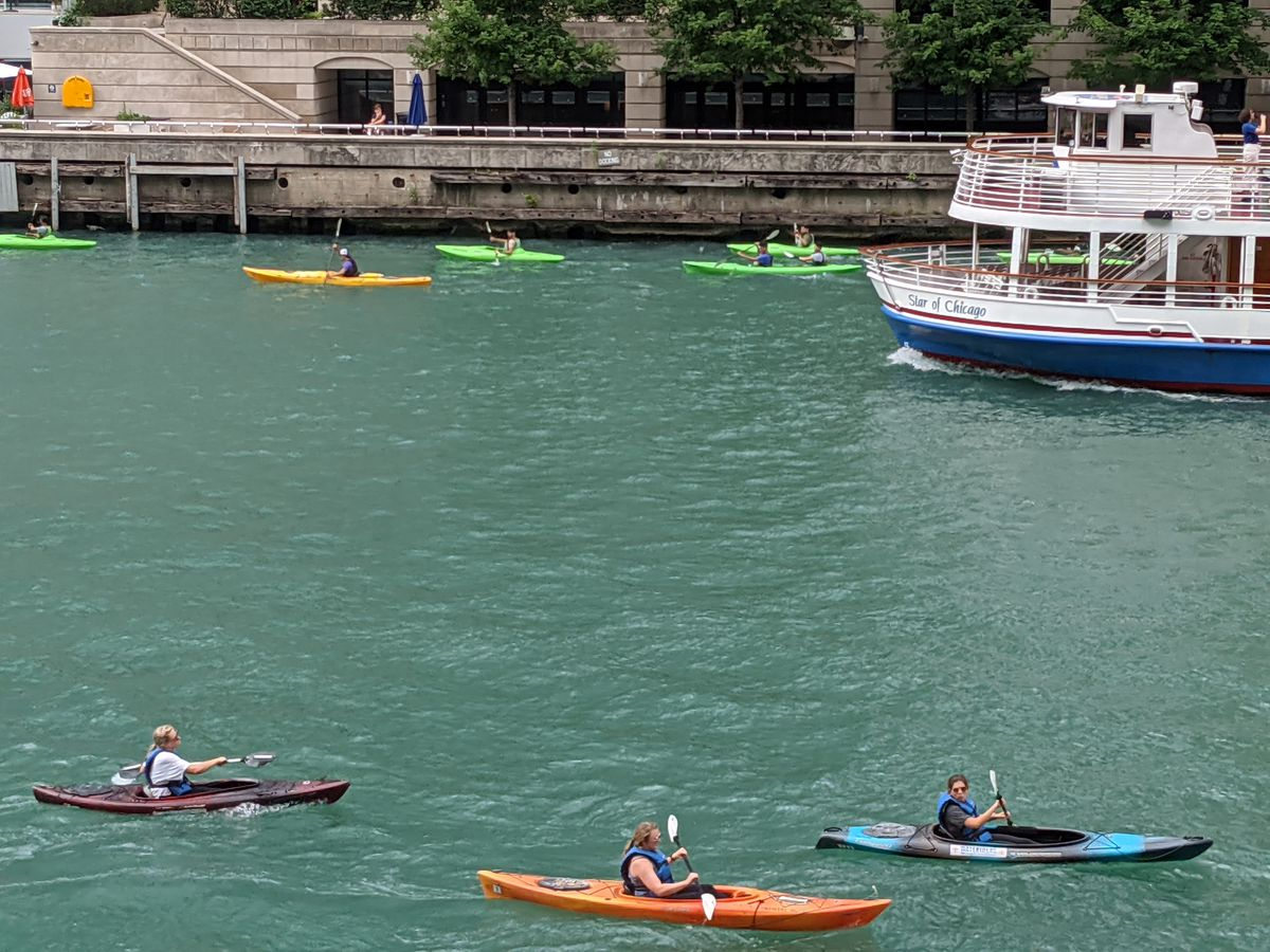 The Chicago River downtown on the main stem is a confluence of many users, including kayakers, tour boats and anglers. Credit: Dale Bowman