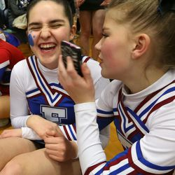 From left, Fremont High School cheerleaders Kennedy Hansen and Kendee Sanders react as they pretend to have a boy on the phone for Hansen at the state championships at Juan Diego Catholic High School in Draper on Saturday, Feb. 15, 2014. In June 2013, when Kennedy Hansen was 15 years old, she was diagnosed with juvenile Batten disease, a rare disorder that generally doesn't manifest itself for the first five to 10 years of a child's life. She died a year later.
