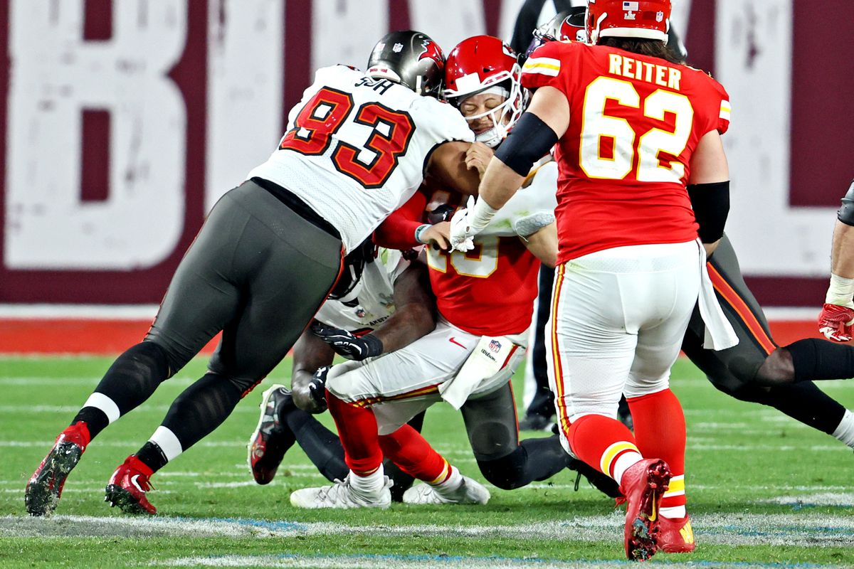 Kansas City Chiefs quarterback Patrick Mahomes (15) is sacked by Tampa Bay Buccaneers defensive end Ndamukong Suh (93) during the fourth quarter in Super Bowl LV at Raymond James Stadium.