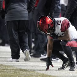 San Diego State running back Jordan Byrd (15) takes a breather in the second half of an NCAA college football game against BYU Saturday, Dec. 12, 2020, in Provo, Utah.