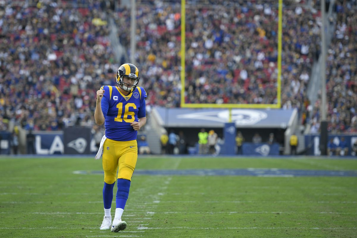 Jared Goff of the Los Angeles Rams pumps his fist after the first touchdown of the game against the Arizona Cardinals at Los Angeles Memorial Coliseum on December 29, 2019 in Los Angeles, California.