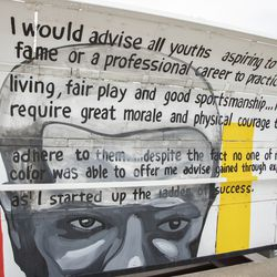 """The Major Taylor Trail Mural is a 400-ft mural on a pedestrian bridge on Little Calumet River by Chicago artist and muralist Bernard Williams, featuring quotes from Taylor's autobiography, 'The Fastest Bicycle Rider in the World."""""""