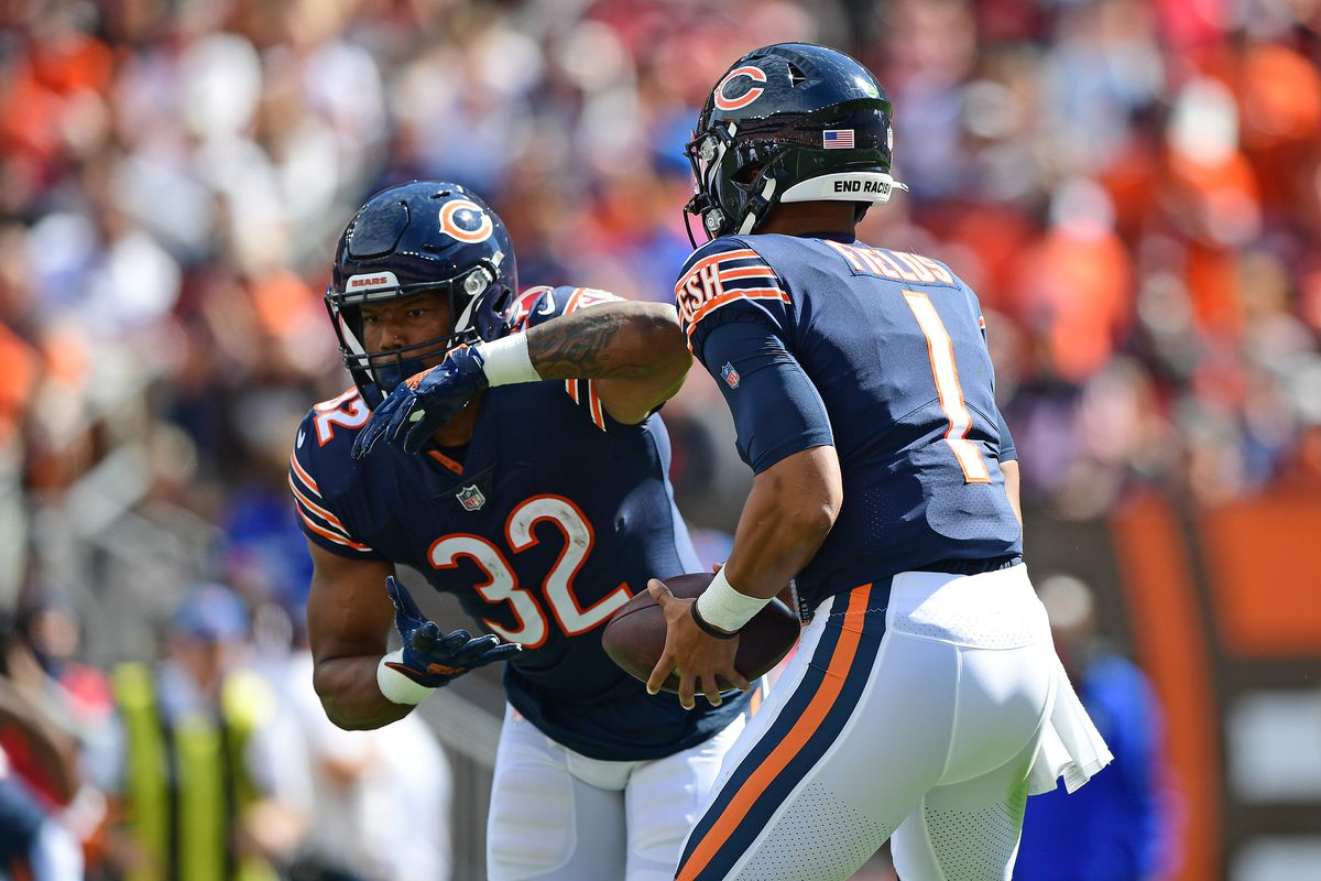 Justin Fields #1 hands the ball to David Montgomery #32 of the Chicago Bears during the second quarter in the game against the Cleveland Browns at FirstEnergy Stadium on September 26, 2021 in Cleveland, Ohio.
