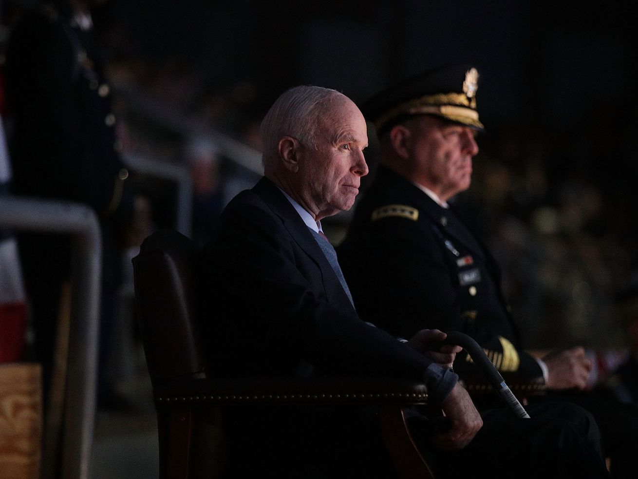 Sen. John McCain watches a special Twilight Tattoo performance with US Army Chief of Staff Gen. Mark A. Milley at Fort Myer in Arlington, Virginia.