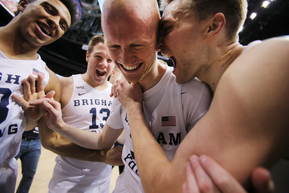 BYU Cougars guard TJ Haws (30) is swarmed by teammates as BYU celebrates their win over Saint Mary's in an NCAA basketball game in Provo at the Marriott Center on Saturday, Feb. 1, 2020. BYU won 81-79.