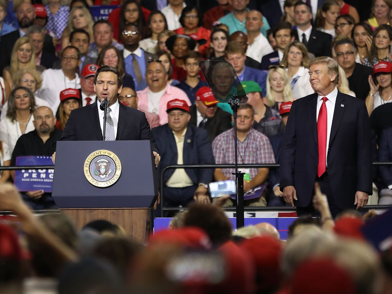 Ron DeSantis onstage with President Donald Trump.
