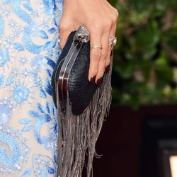 Her cool fringed clutch