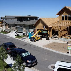 Construction of energy-efficient homes is underway in Sandy on Friday, Aug. 12, 2016. Utah is one of only 10 states in the nation that allow energy ratings to be part of updated residential building codes so consumers can see if the home they are about to buy will be efficient and save them money on their utility bills.