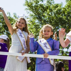 Members of the Regal Majesty Pageant wave during the Days of '47 Union Pacific Railroad Youth Parade held Saturday, July 18, 2015, in Salt Lake City.