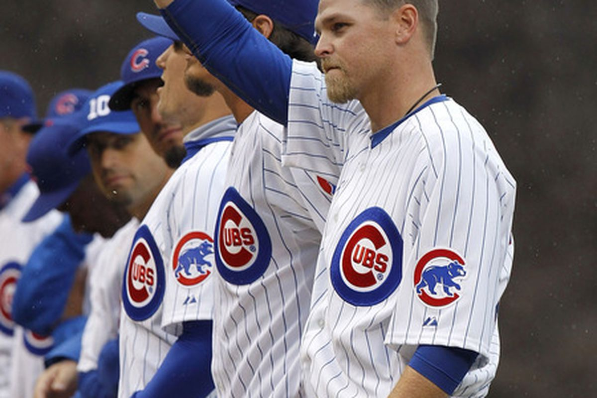 Kerry Wood of the Chicago Cubs tips his hat to fans during player introductions prior to playing the Pittsburgh Pirates on opening day at Wrigley Field in Chicago, Illinois. (Photo by Gregory Shamus/Getty Images)