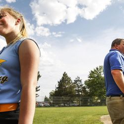 Brad Thomas, right, who has been coaching his daughter's accelerated softball team for the past five years, takes the field with his daughter, Faith Thomas, during a scrimmage at Dewey Bluth Park in Sandy, Utah, Thursday, June 9, 2016.