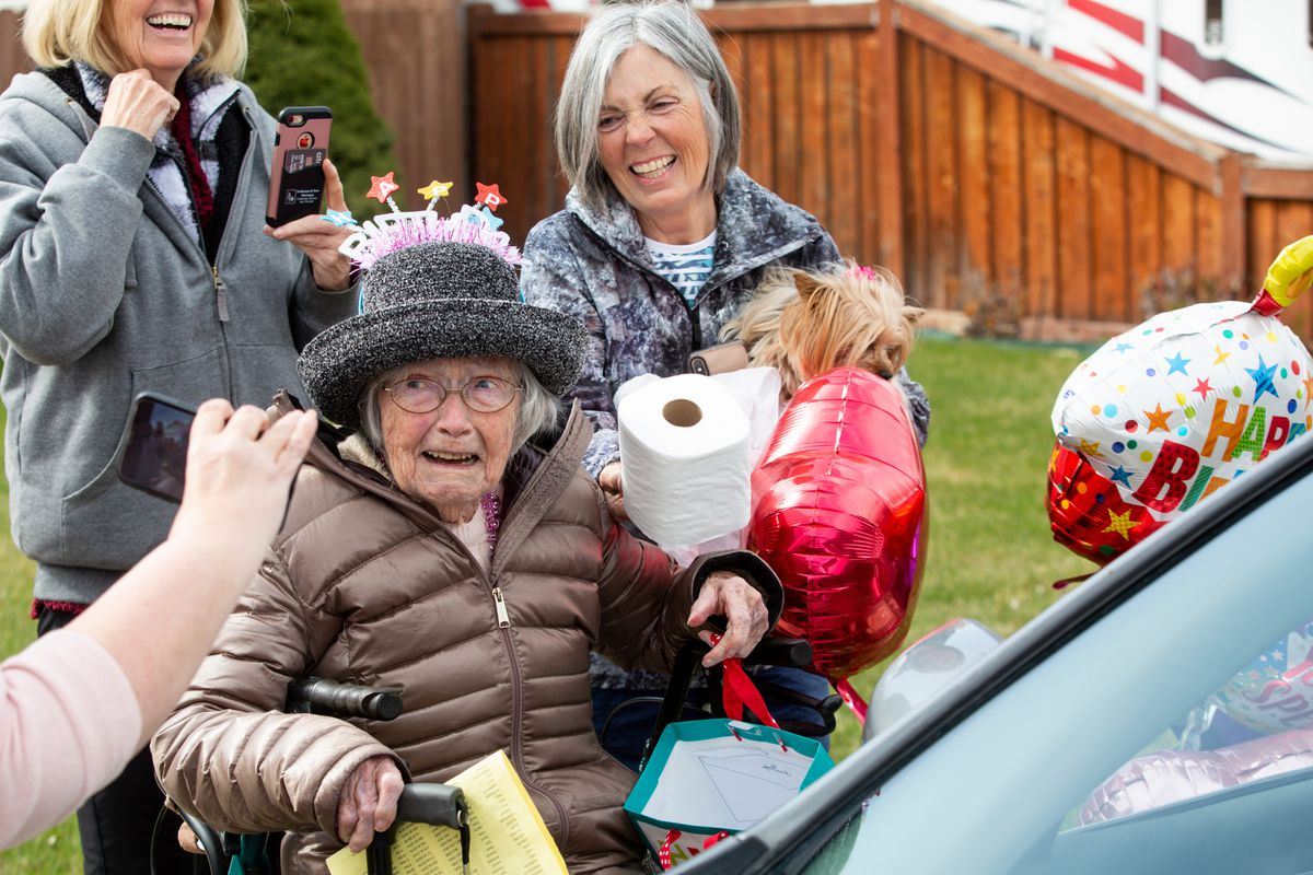 """Nada Stevenson reacts to a roll of toilet paper, a gift, she received from a paradegoers who stopped in front of her home during her 100th birthday celebration in Orem on Saturday, March 28, 2020. """"Hopefully it'll last till she dies,"""" Tami Stevenson, Nada's daughter, who is holding the roll for her, joked. """"I thought nobody can come 'cause of the quarantine, but they found a way to do it. It was very interesting,"""" Nada Stevenson said. """"I'm very blessed with my family."""""""