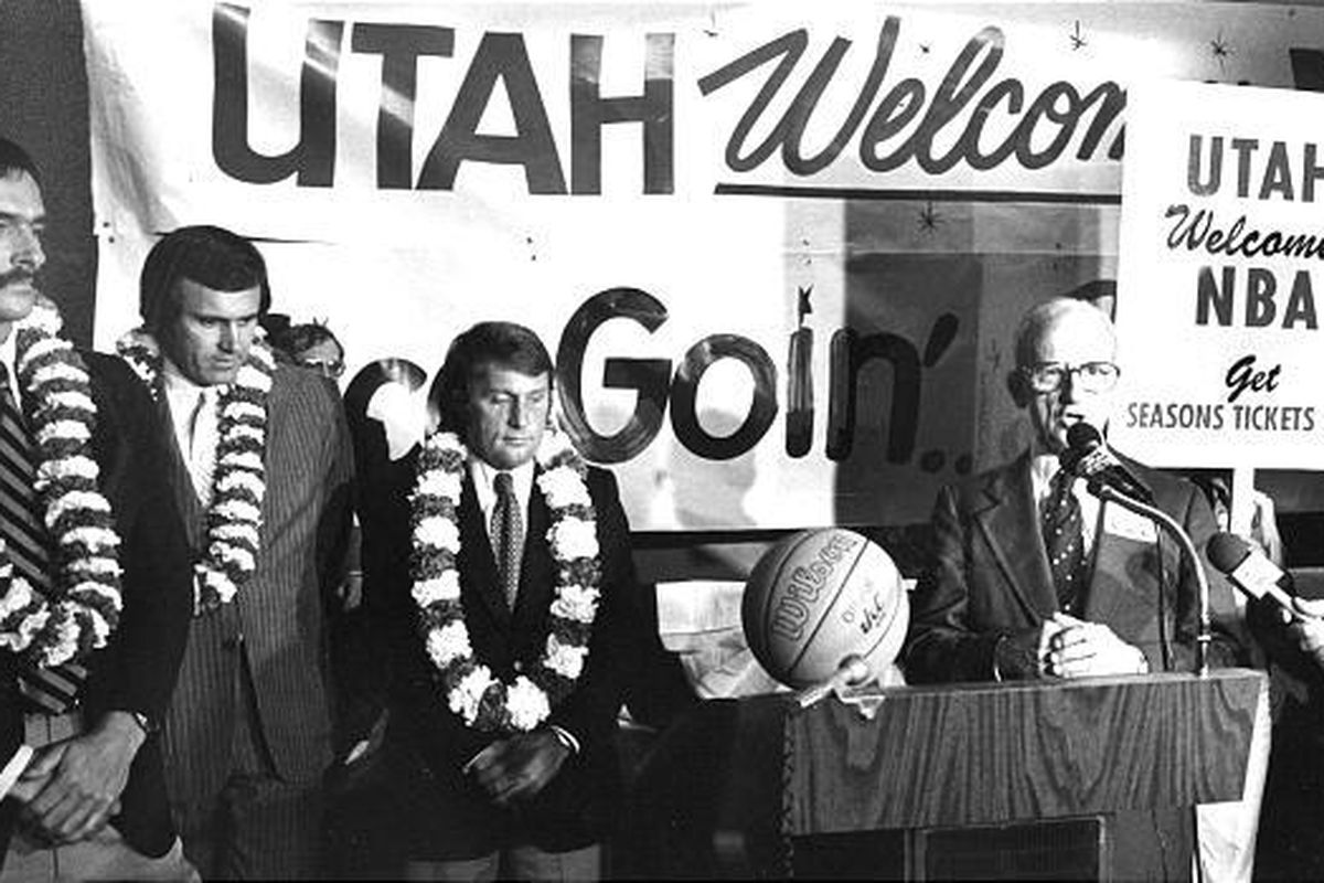 Former Jazz owners Sam Battistone and Larry Hatfield (second and third from left), shown here being welcomed to Utah in 1979, kept the Jazz team name from the few years of playing in New Orleans.