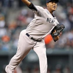 New York Yankees starting pitcher Ivan Nova throws against the Baltimore Orioles in the first inning of a baseball game in Baltimore, Monday, April 9, 2012.