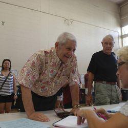 Hawaii state Sen. Sam Slom checks in at the Holy Trinity Catholic Church polling place to vote on Nov. 8, 2016.