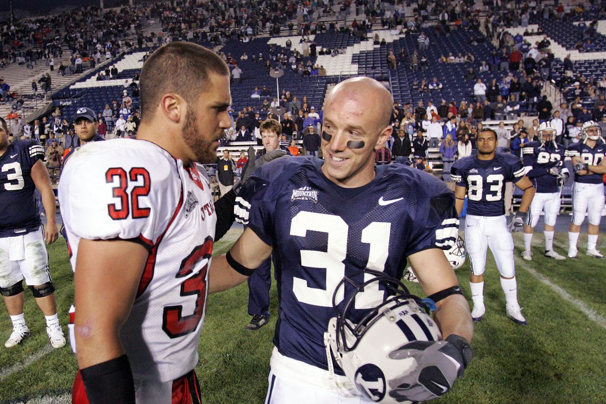 BYU's Nathan Meikle, right, talks with Utah's Eric Weddle after game Nov 19, 2005 in Provo. Utah won in overtime.