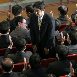 Former Prime Minister Shinzo Abe bows after winning the party leader election of Japan's main opposition Liberal Democratic Party in Tokyo, Wednesday, Sept. 26, 2012.  Abe, who was prime minister for a year before abruptly resigning in 2007 with an intestinal ailment, would most likely get another shot at leading Japan if polls prove correct and the LDP wins the most seats in the next election.