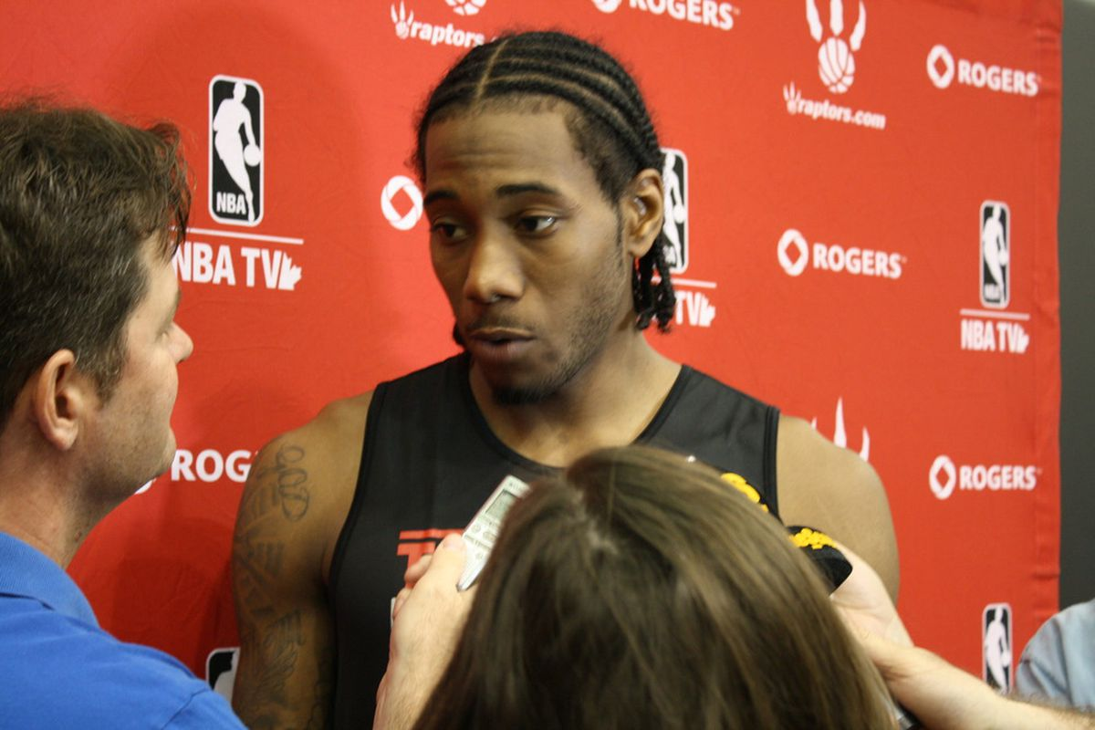 Kawhi Leonard talks to the media after yesterday's workout session.