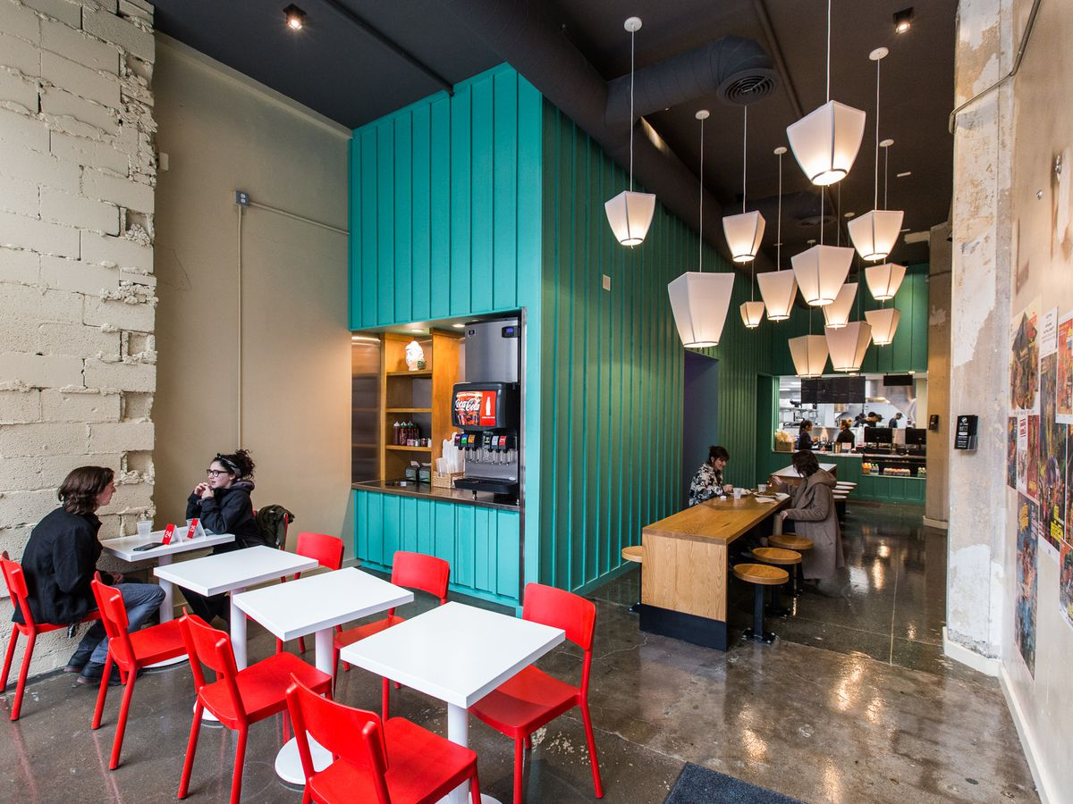the blue walk-up counter at go! sy thai with red chairs and white tables and a long wood table